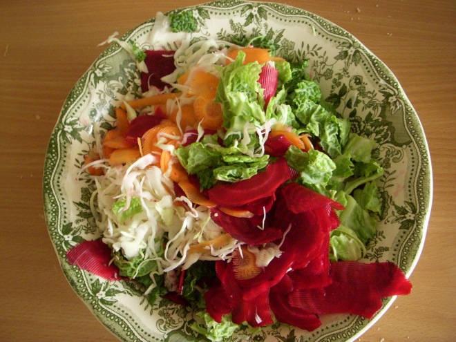 tossed green mixed cabbage and beet salad